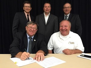 The South Dakota Soybean Association signed ASA's new affiliate agreement during the July board meeting. Front row: ASA President Richard Wilkins and South Dakota Soybean Association President Jerry Schmitz. Back row: ASA Director Kevin Scott; Executive D