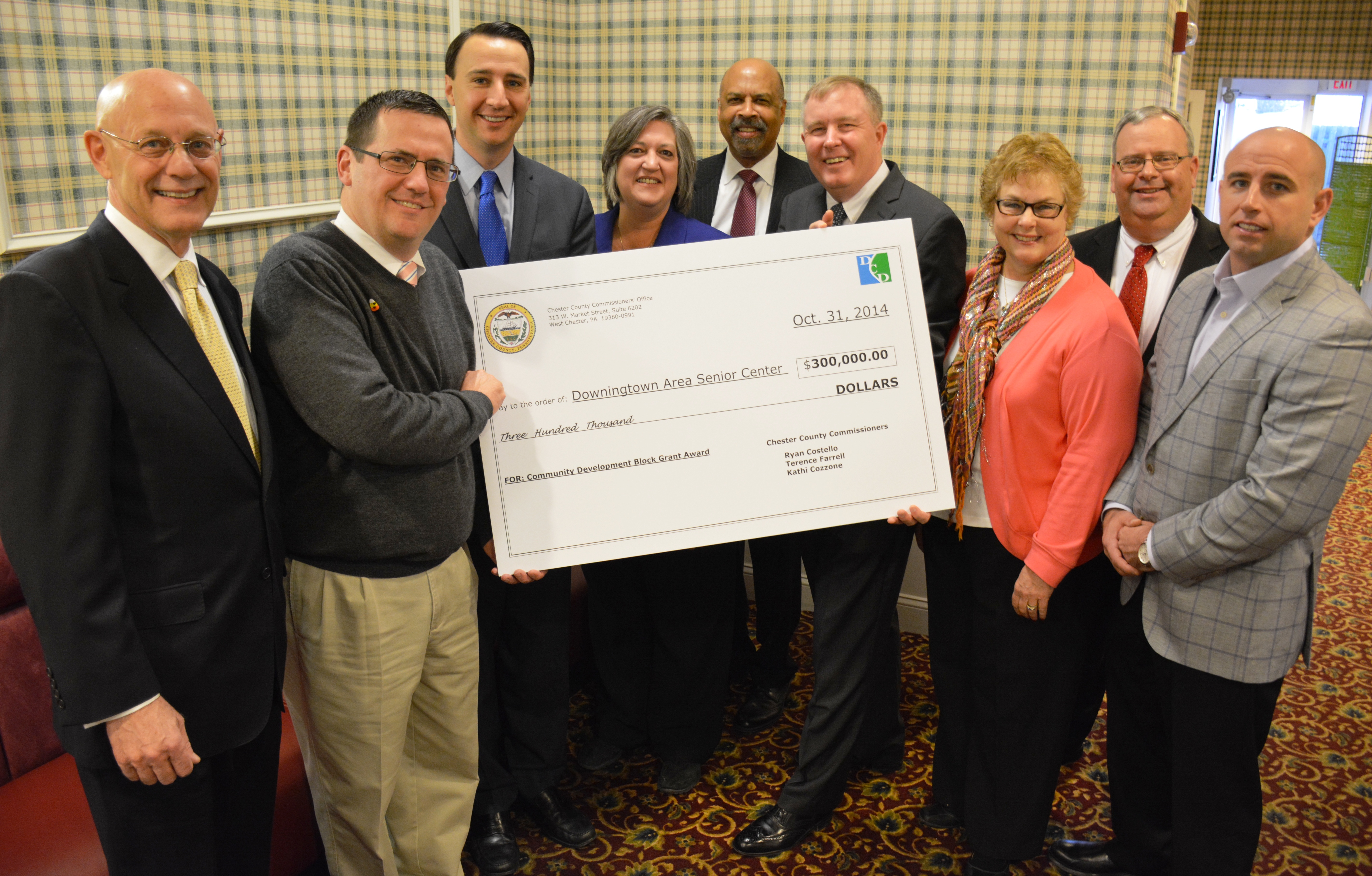 Chester County commissioners present the Downington County Senior Center with a $300,000 check for building upgrades.
