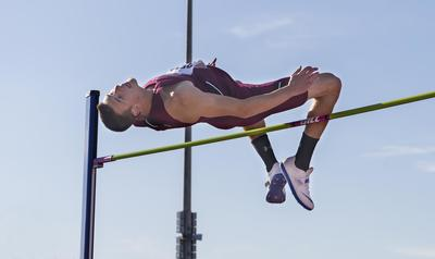 Kyle Landon competes in the high jump. Landon recently graduated from SIU.