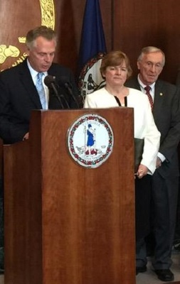 Gov. Terry McAuliffe, at left, and Judge Jane Marum Roush at a press conference on Monday.