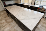 The uses for Carrara marble run the gamut from countertops to complete walls.