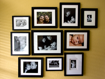 A well-arranged wall display can make an artsy reminder of family.
