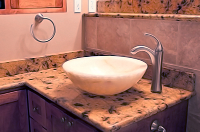 A stone vessel sink makes for a striking bathroom feature.