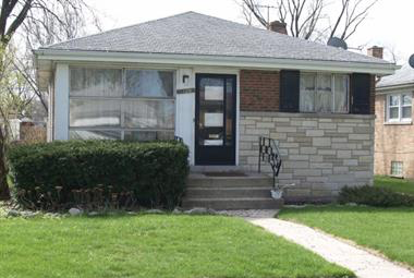 This red and white stone bungalow at 3106 Monroe Street in Bellwood was lost to foreclosure in 2009.