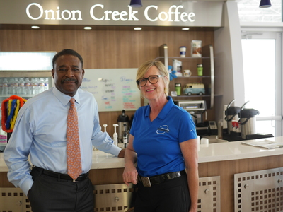 "Carl Barnett, owner of Onion Creek Volkswagen, and Catherine ""Cat"" Young, barista and coffee bar manager, have created a friendly culture of camaraderie and coffee for dealership customers."