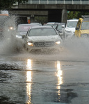 Cars drive on a flooding road during a rain storm on Nov. 29, 2018 in Los Angeles.