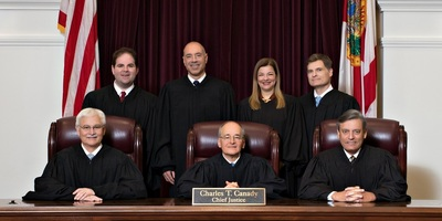 Florida Supreme Court. Front row, from left, Justice Ricky Polston, Chief Justice Charles T. Canady and Justice Jorge Labarga. Back row, from left, Justice Robert J. Luck, Justice Alan Lawson, Justice Barbara Lagoa and Justice Carlos G. Muñiz.