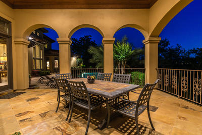 The large, covered cabana is perfect for outdoor dining and entertaining by the pool.