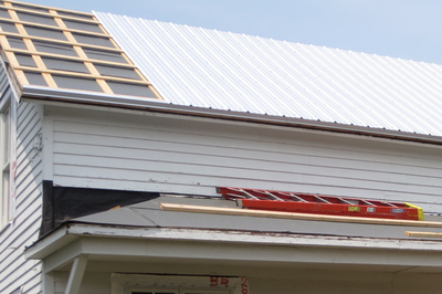 Metal roofs are expensive compared with shingles, but require less maintenance and last longer.