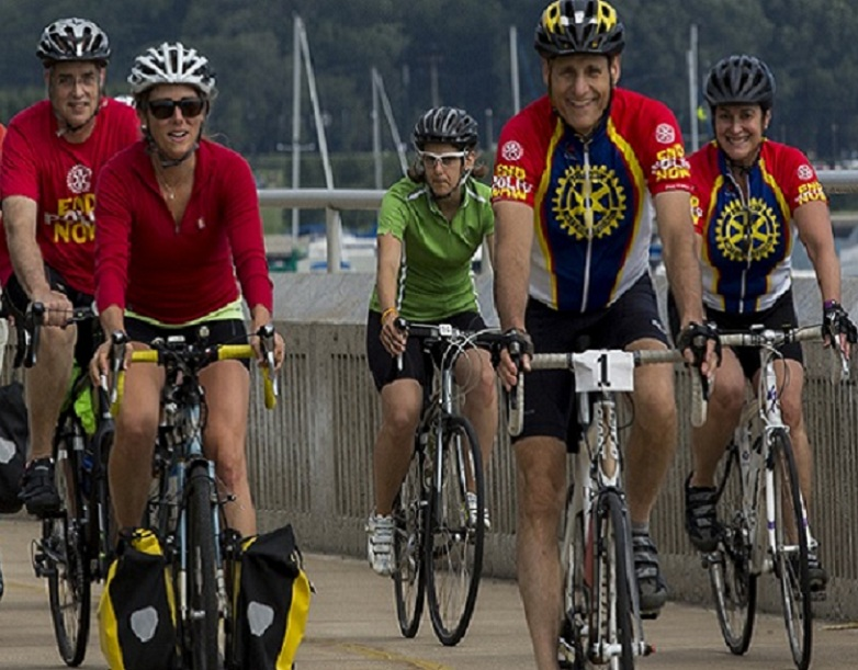 Rotary staff members and General Secretary John Hewko bike along  Lake Michigan in Chicago.