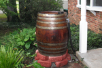 An ornamental rain barrel can actually be useful and save money on water.