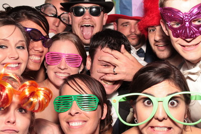 A group of folks have fun in a Live Oak Photo Booth.
