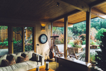 Screening in a porch area offers a living space with the best of both the interior and outside world.