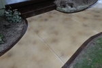 Applying a good stain to concrete will immediately enhance its appearance.