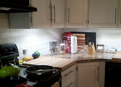 Under-cabinet lighting is an efficient way to illuminate the places in the kitchen where work is actually done.