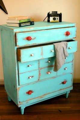 Paint a piece of furniture, and use chains or other tools to give it a rustic look.