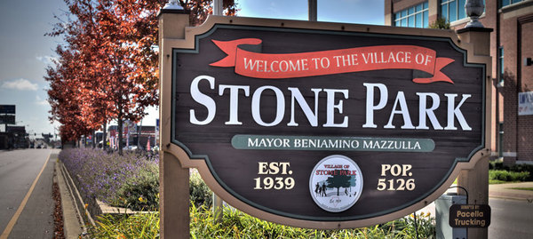 Large village of stone park sign