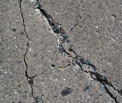 Cracks in a driveway can be sealed with a sealant like Sakrete Blacktop Crack Filler, which sells for about $10.