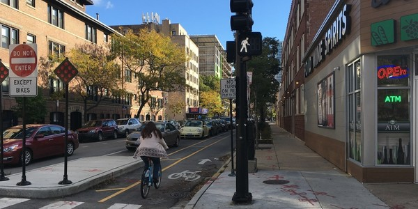 Large contraflow parking protected bikeway