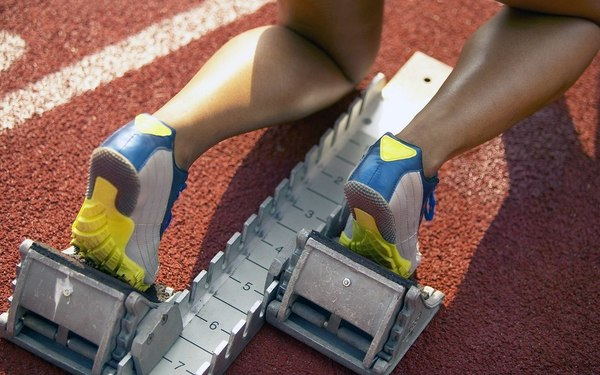 Large athletic feet at starting block